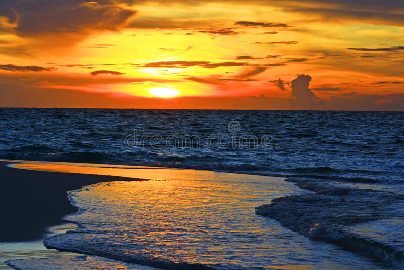 Beach sunset maldives. Sunset at eriyadu island beach at north male atoll maldives royalty free stock photo