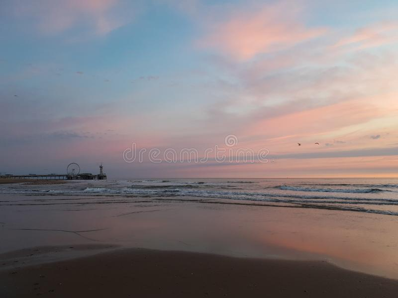 Beach sunset pier the Netherlands stock photo