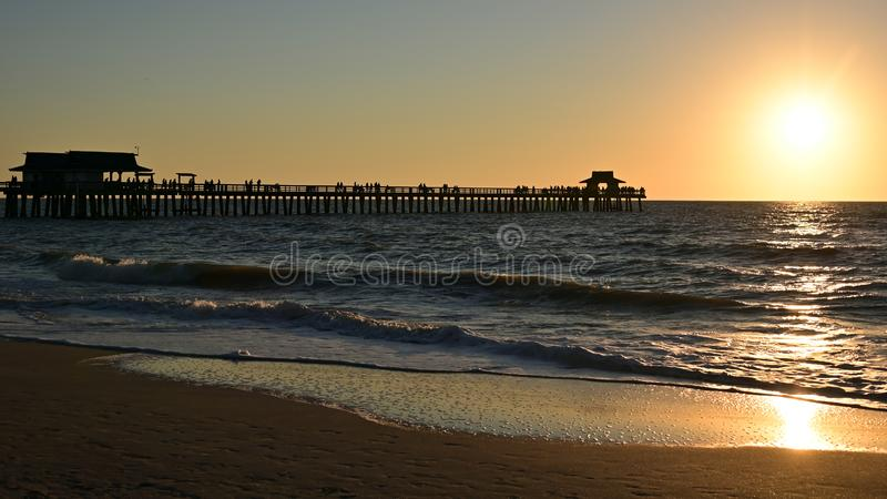 Beach sunset and pier royalty free stock images