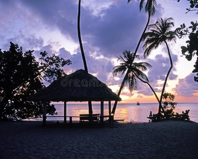 Beach at sunset, Pigeon Point, Tobago. stock photo