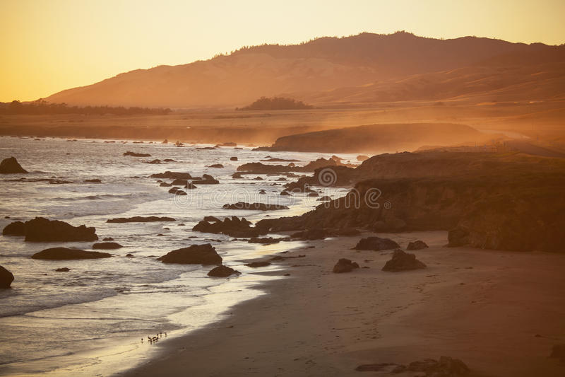 Beach at sunset, San Simeon stock image