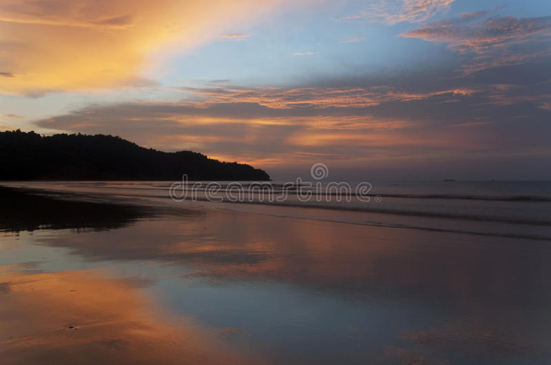 Beach sunset on tropical island royalty free stock images