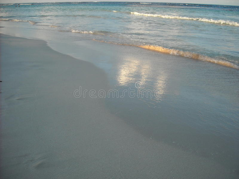 Beach at Sunset, Vieques, Puerto Rico. The pristine white sand on a beach on the island of Vieques, Puerto Rico accepts the gentle waves royalty free stock photography