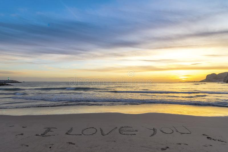 Beach at sunset in winter royalty free stock photography