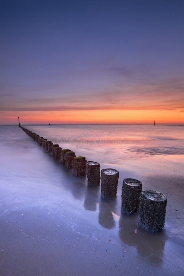 Beach at sunset in Zeeland, The Netherlands stock photos