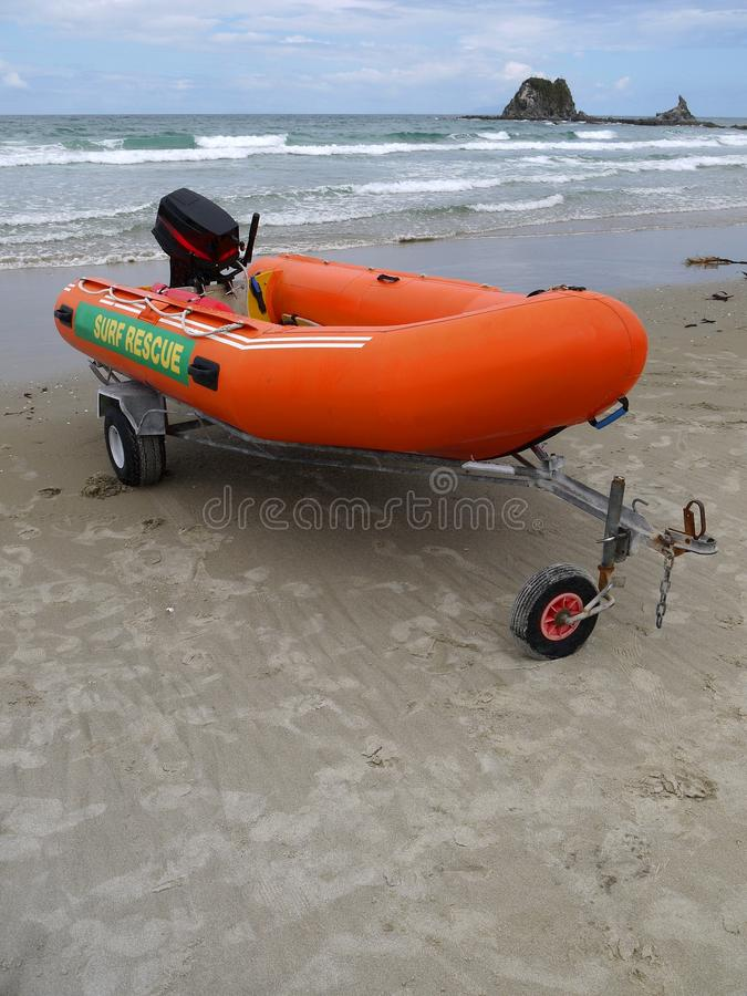 Beach: surf life-saving inflatable boat. Beach with surf life-saving inflatable boat, Mangawhai, Northland, New Zealand stock images