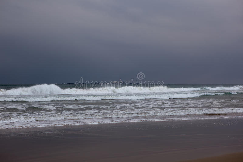 Beach surf in storm stock images
