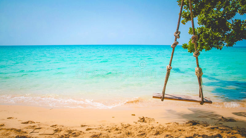beach with swings royalty free stock images