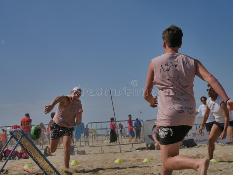 Beach TchoukBall Festival 2018 - Open. Athletes playing in Beach Tchoukball Open Tournament. The final match : Giovani Fuori Classe Vs. Thereferisti Beach royalty free stock images