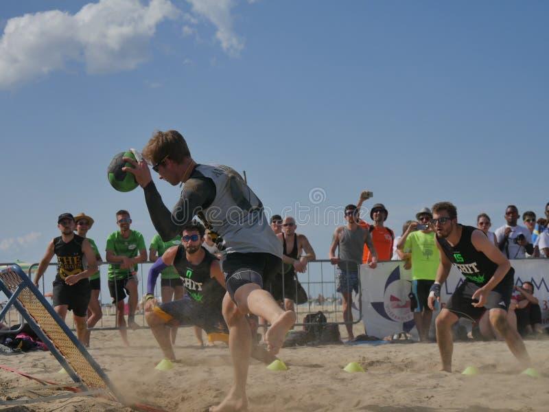 Beach TchoukBall Festival 2018 - Slam. Athletes playing in Beach Tchoukball Slam Tournament. The final match : The Zeroes Vs. De Chit Beach TchoukBall Festival royalty free stock image