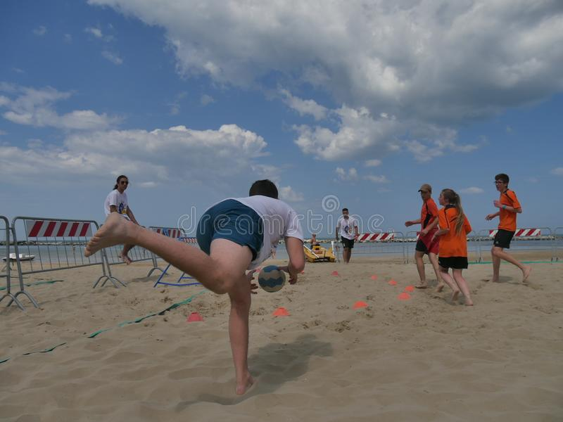 Beach TchoukBall Festival 2018 - Under. Athletes playing in Beach Tchoukball Under Tournament.nBeach TchoukBall Festival - Viserba Rimini - May 2018 royalty free stock photos
