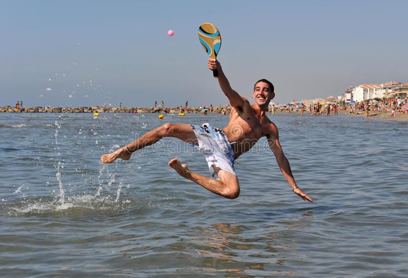 Beach tennis in the sea royalty free stock image