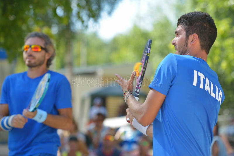Beach Tennis World Team Championship 2014. Moscow, Russia - July 20, 2014: Marco Garavini (center) and Alessandro Calbucci of Italy in the final match against stock photography
