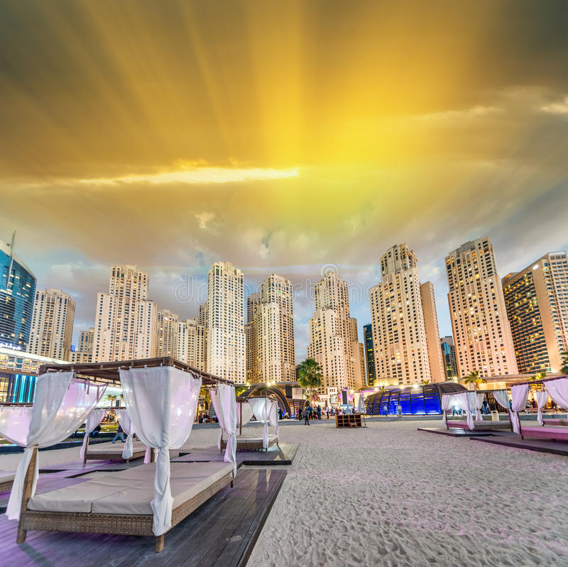 Beach Tents and Dubai Marina Skyline at dusk.  stock photography