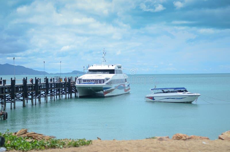 Boats on a beach in Thailand stock photos