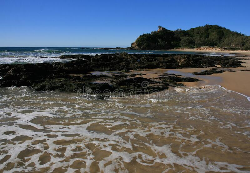 Beach tide coming in stock images