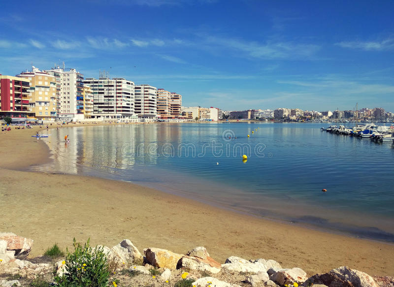 Beach of Torrevieja at sunny weather. Costa Blanca, Province of. Alicante. Spain royalty free stock photography
