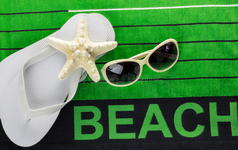 Beach towel and flip flops royalty free stock image