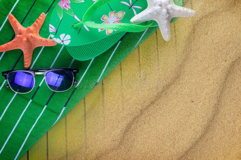 Beach towel on sand stock images