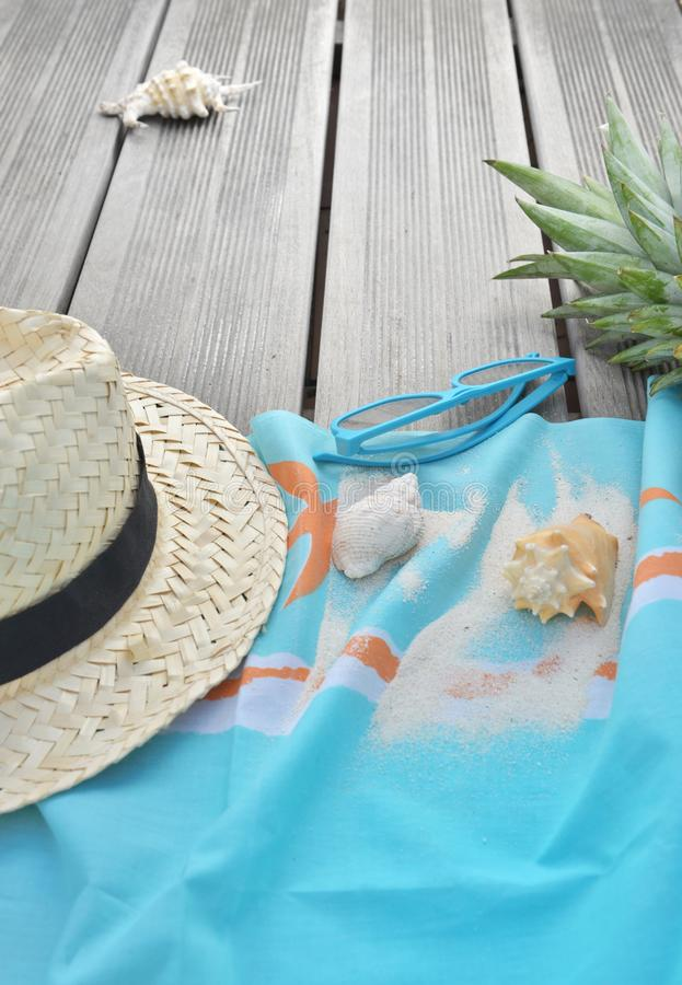 Free Beach Towel With Sunglasses And Pineapple On Wooden Terrace Stock Photo - 148925120