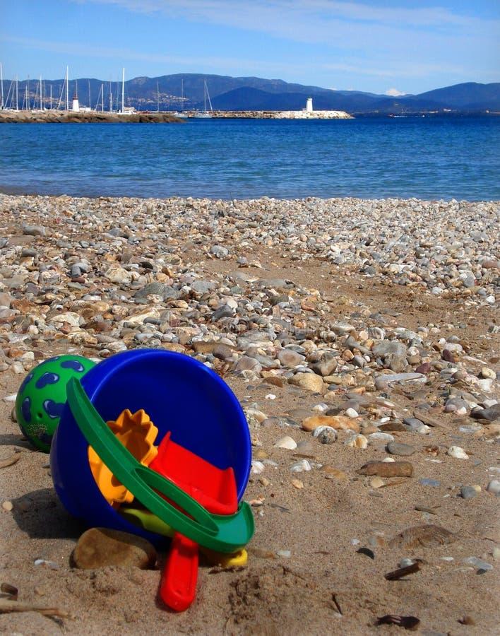 Beach toys. On st tropez lighthouse royalty free stock photography