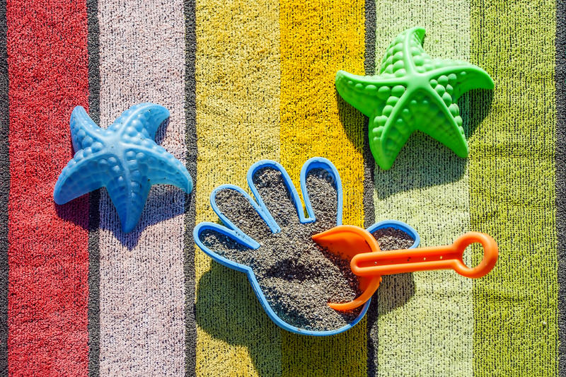 Beach Toys On A Towel stock photos