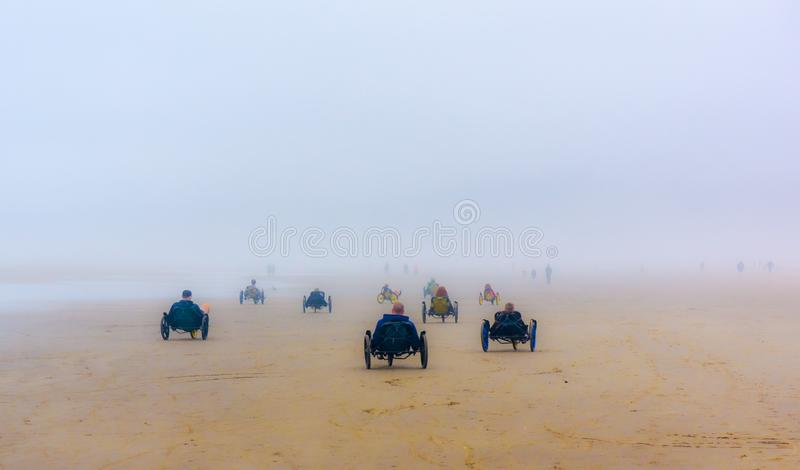 Beach tricycles in fog royalty free stock photography