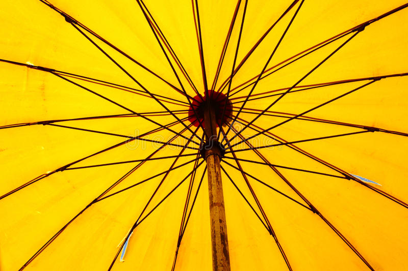 Beach umbrella. Close up bottom view of a yellow beach umbrella royalty free stock photography