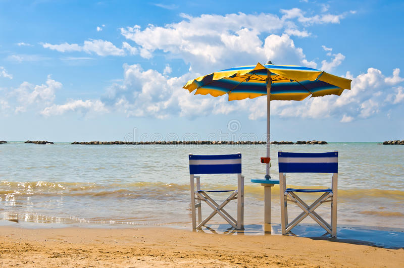 Beach Umbrella. Parasol on the beach in a sunny day with soft clouds stock image