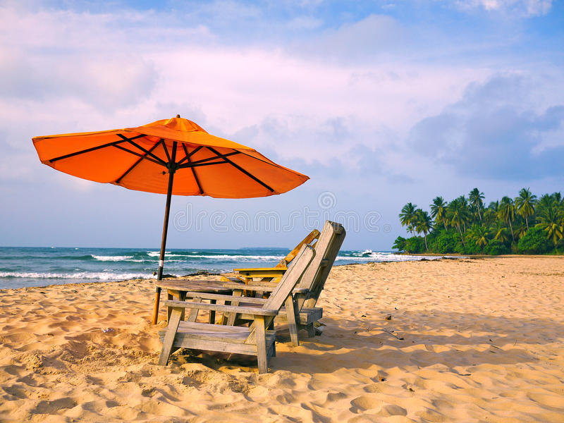 Beach and umbrella royalty free stock images