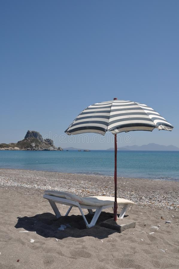 Beach umbrella and chair stock image