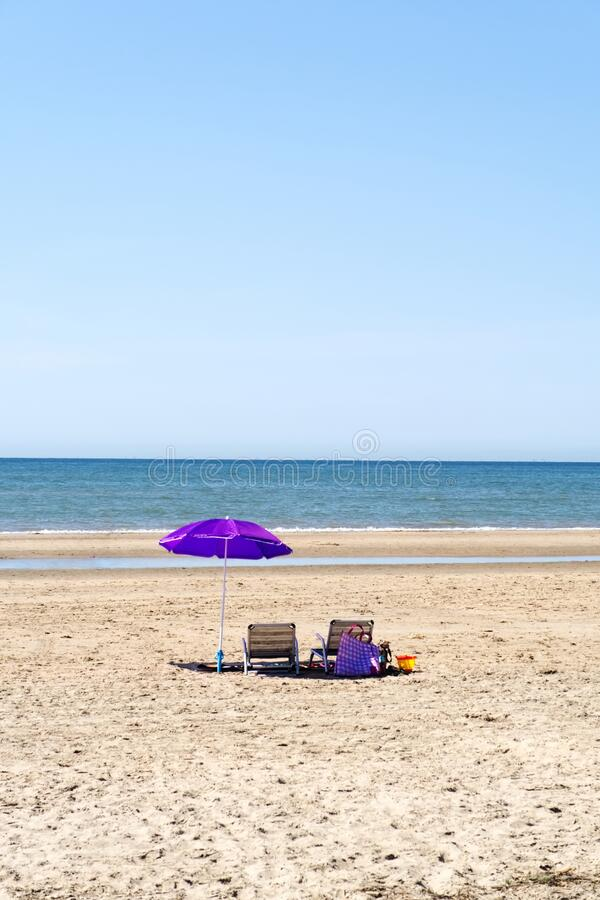 Beach with umbrella and chairs royalty free stock photo