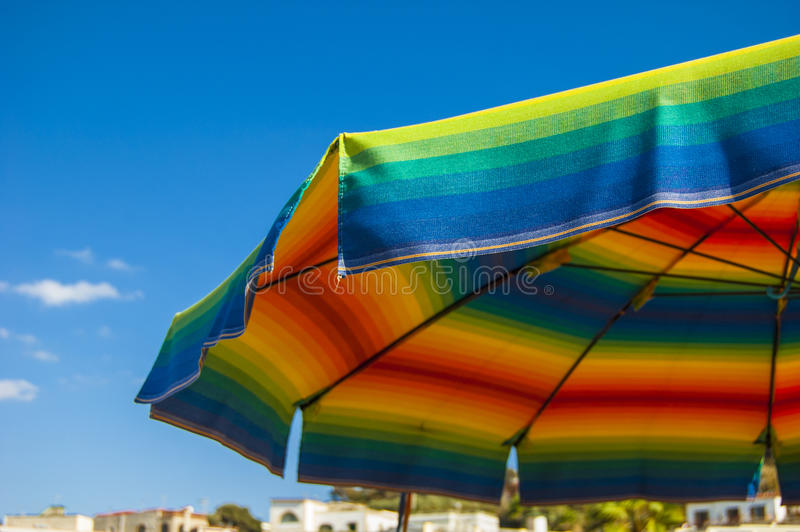 Download Beach Umbrella Colored Like A Rainbow Stock Photo - Image of horizon, tropical: 34174122