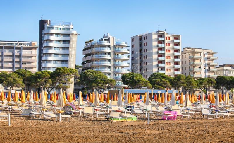 Beach with umbrella in Lignano Sabbiadoro stock afbeelding