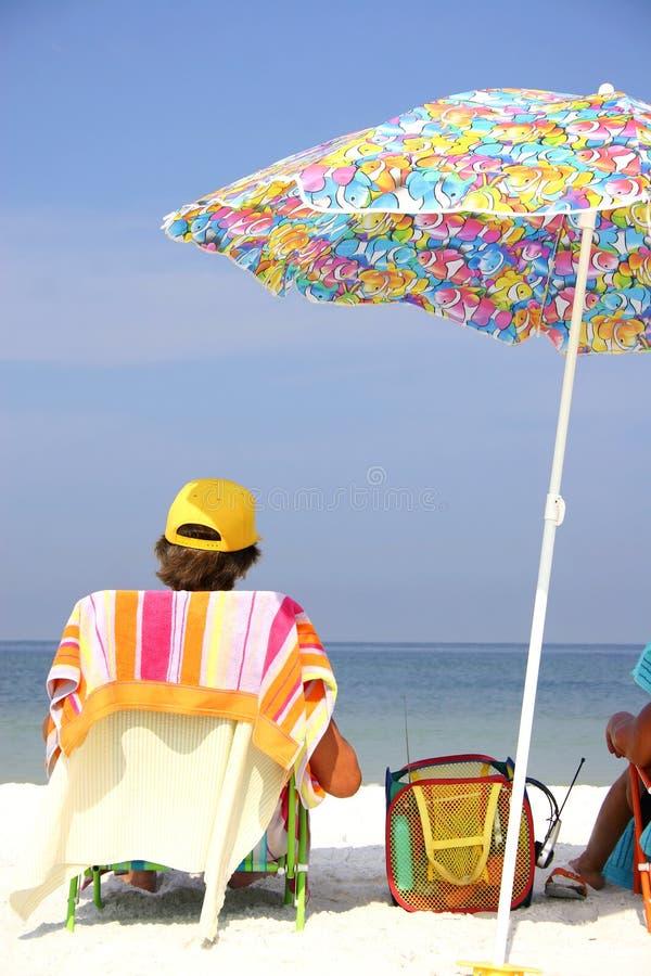 Beach Umbrella Man royalty free stock photography