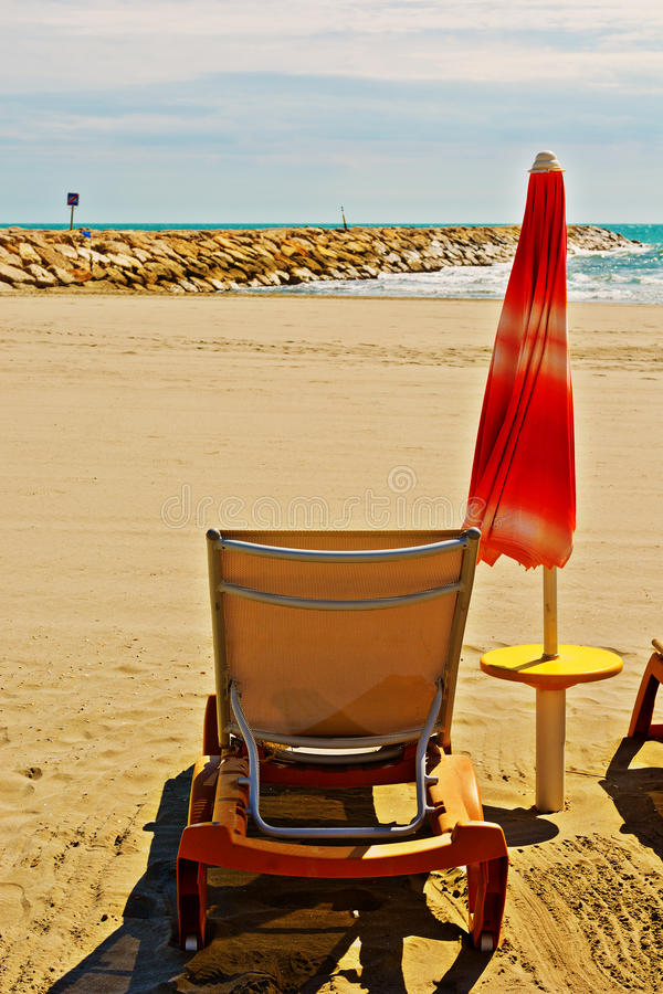 Beach. Umbrella and Sun Bed in the Low Season stock photo