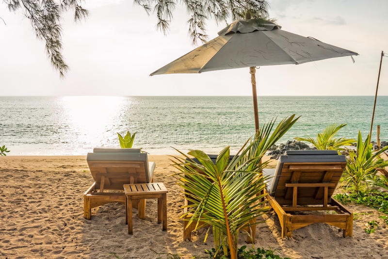 Beach umbrella and sunbath seats on Pak Weep beach in the evening. The beach is in Southern Thailand royalty free stock photography