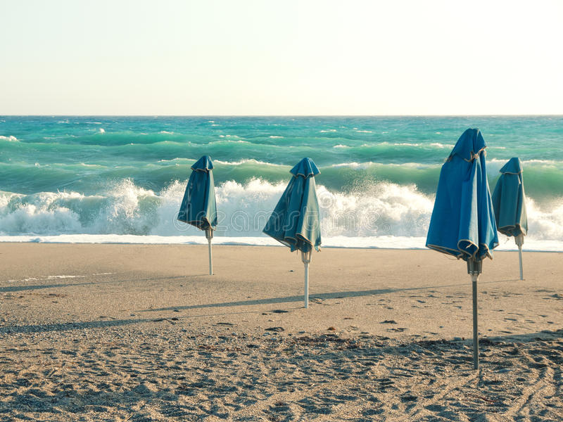 Download Beach umbrellas stock photo. Image of gale, blue, storm - 32000300