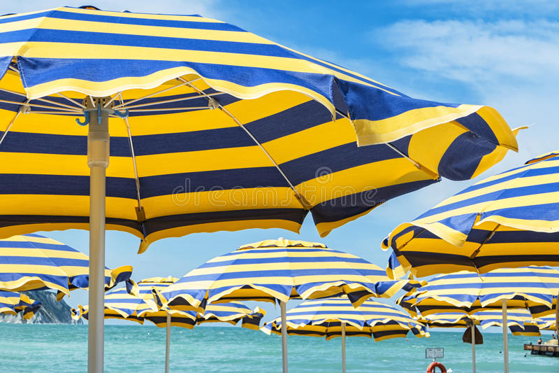 Beach umbrellas. Opened during summer season stock images