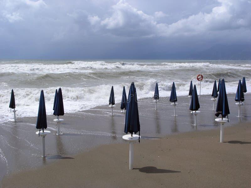Beach umbrellas in the sand stock image