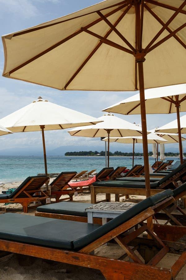 Beach umbrellas with sun beds on the beach royalty free stock photos