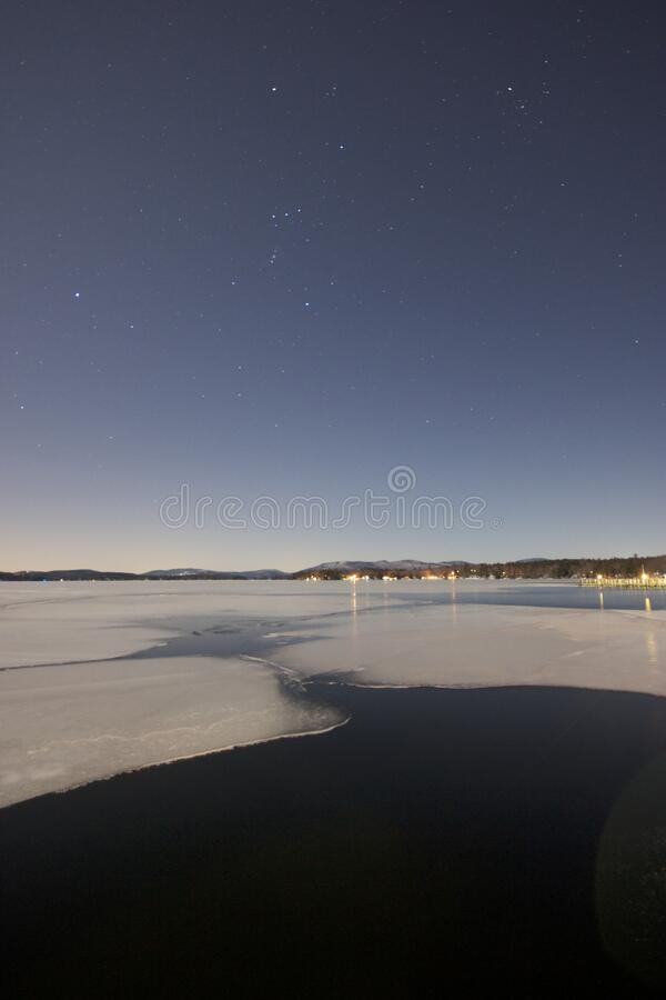 Beach under starry sky at night stock photo