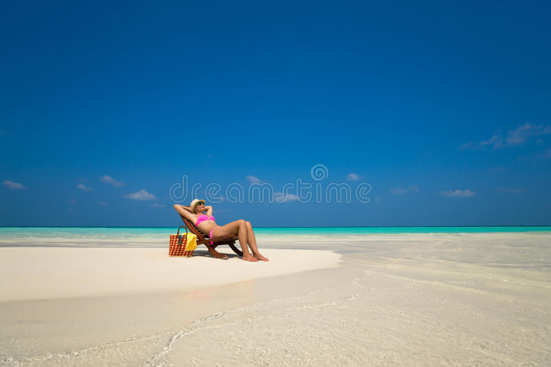 Beach vacation. Hot beautiful woman enjoying looking view of beach royalty free stock image