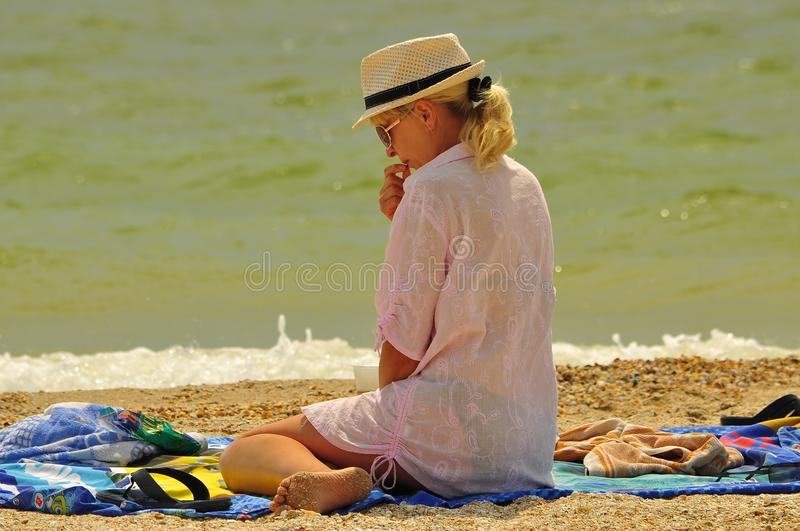 Beach, Vacation, Sand, Sitting royalty free stock image