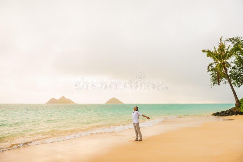 Beach vacation woman happy feeling free on Lanikai beach, Hawaii paradise honeymoon destination for USA summer travel holidays. stock image