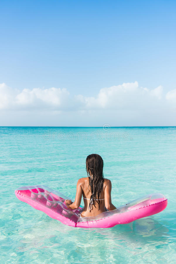 Beach vacation woman relaxing on an ocean mattress royalty free stock photos