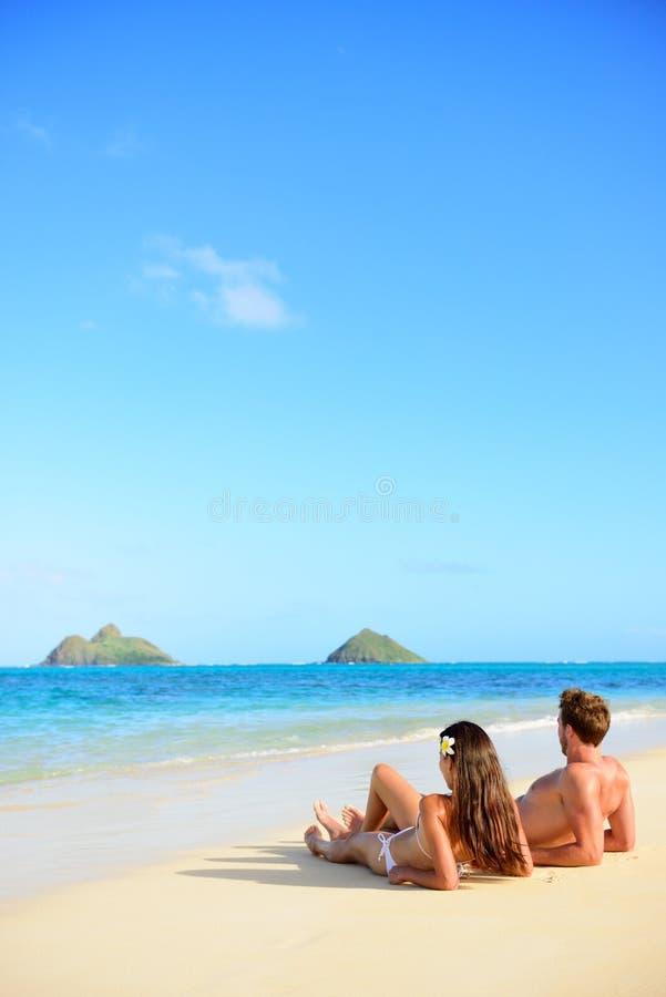 Free Beach Vacations Suntan Couple Relaxing In Hawaii Stock Photos - 49529943