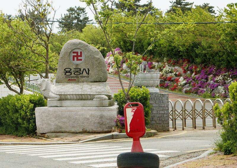Busan, South Korea, Road stone - pointer to Haedong Yonggungsa Temple. On the beach is a very beautiful Buddhist Haedong Yonggungsa Temple stock images