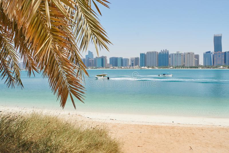 Beach view on abu dhabi skyline royalty free stock photo
