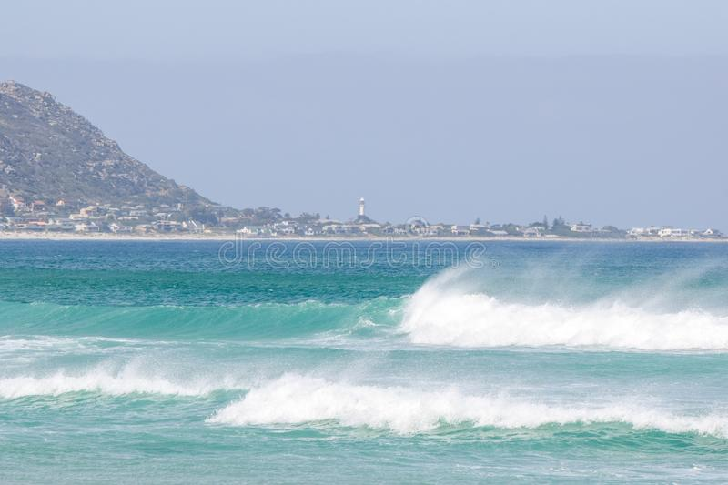 Beach view of the towns of Kommetjie and Klein Slangkop on the Cape Peninsula near Cape Town. South Africa, seen from Noordhoek Long Beach. Beautiful waves and stock photo